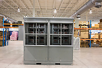 An electronic control system enclosure known as a PQ-IVR is seen in the old headquarters of AMSC, also known as American Superconductor, in Devens, Massachusetts, USA, seen on Tues., Jan. 30, 2018. AMSC was the victim of the theft of trade secrets, starting in 2011 when the Chinese company Sinovel worked to steal and modify AMSC's proprietary wind turbine-running software. Sinovel was AMSC's largest customer, and McGahn estimates that 70% of China's wind turbines now run software stolen from AMSC. AMSC has received favorable judgments from American and Chinese courts, and the company contends that it is owed billions of dollars as a result of the theft, which almost destroyed the company. When news of the theft came out, the company's stock value decreased substantially and went from approximately 800 employees to fewer than 200. The company has rebounded some since the crime.