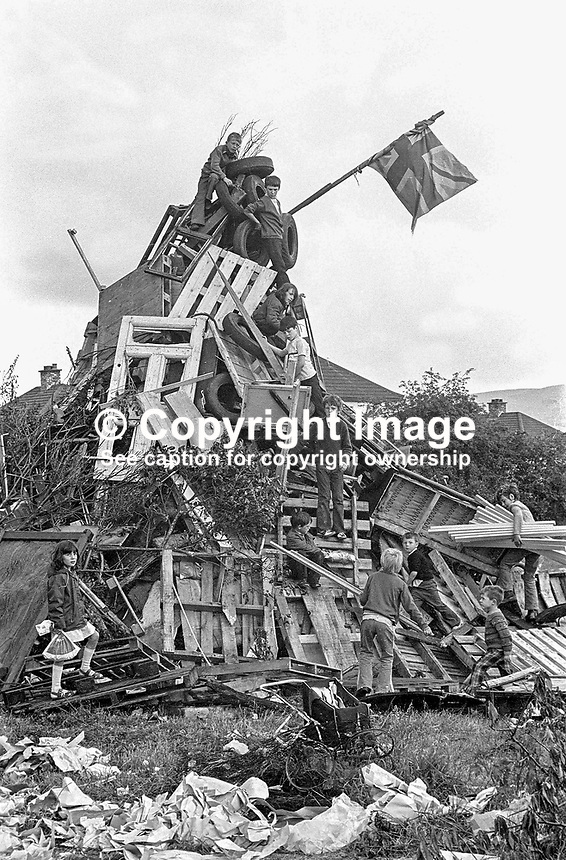 Children building a traditional Eleventh Night bonfire on a Belfast housing estate, N Ireland. The widespread bonfires were a precursor to the Orangemen's Twelfth of July parades the following day. 1974071103871/2, 387/74.<br /> <br /> Copyright Image from Victor Patterson, 54 Dorchester Park, Belfast, UK, BT9 6RJ<br /> <br /> t: +44 28 90661296<br /> m: +44 7802 353836<br /> vm: +44 20 88167153<br /> e1: victorpatterson@me.com<br /> e2: victorpatterson@gmail.com<br /> <br /> For my Terms and Conditions of Use go to www.victorpatterson.com