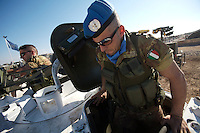 An Italian soldier from first Platoon, Montebello Squadron, Fifth  Lancieri of Novara regiment of the Italian Cavalry exits his driver's seat after  a routine patrol in the UNIFIL Chama base in Southern Lebanon on Friday Dec 08 2006..Close to 1000 Italian peacekeepers operate in  the in Southern lebanon town of Chama, constantly patrolling their sector in search for illegal weapons in the country.