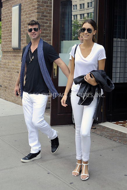 WWW.ACEPIXS.COM<br /> <br /> June 11 2015, New York City<br /> <br /> Robin Thicke and girlfriend April Love Geary leaving a downtown hotel on June 11 2015 in New York City.<br /> <br /> <br /> Please byline: Curtis Means/ACE Pictures<br /> <br /> ACE Pictures, Inc.<br /> www.acepixs.com, Email: info@acepixs.com<br /> Tel: 646 769 0430