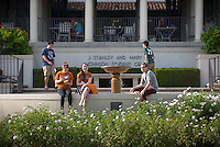 Occidental College students take a break near the small fountain outside the Johnson Student Center (JSC) during Orientation on August 25, 2014. (Photo by Marc Campos, Occidental College Photographer)