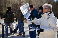 NWA Democrat-Gazette/CHARLIE KAIJO Tour guide  Diane Gately holds a picture and shows the site of the Van Winkle home to a tour group during a hike on Monday, January 1, 2018 at the Van Winkle sawmill trail in Rogers.<br />