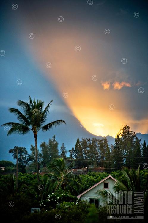Sunset rays over residential Kapa'a, East Kaua'i.
