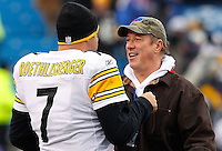 PITTSBURGH - NOVEMBER 28:  Ben Roethlisberger #7 of the Pittsburgh Steelers talks with former Buffalo Bills quarterback Jim Kelly prior to the game on November 28, 2010 at Heinz Field in Pittsburgh, Pennsylvania.  (Photo by Jared Wickerham/Getty Images)