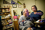 In Home Supportive Services (IHSS) caregiver Teresita Perez de Godoy, right, helps quadriplegic Francisco Godoy use the computer in his Sacramento, CA home January 22, 2010. Francisco needs around-the-clock care from Teresita, his ex-wife who also lives with him. The state pays Teresita for 283 hours per month, at $10.40/hour. Gov. Schwarzenegger has proposed cutting or eliminating the IHSS program which provides care for 450,000 Californians and jobs for 375,000 caregivers. If the program was eliminated, most would need to be institutionalized, likely at far greater taxpayer expense. CREDIT: Max Whittaker for The Wall Street Journal.CABUDGET