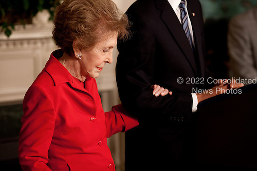 Washington, DC - June 2, 2009 -- Former First Lady Nancy Reagan embraces President Barack Obama's arm at the podium as he announces and signs the Ronald Reagan Centennial Commission Act in the Diplomatic Room of the White House, June 2, 2009.<br /> Mandatory Credit: Pete Souza - White House via CNP