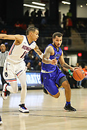 Washington, DC - December 22, 2018: Hampton Pirates guard Jermaine Marrow (2) is being guarded by Howard Bison guard Kyle Foster (11) during the DC Hoops Fest between Hampton and Howard at  Entertainment and Sports Arena in Washington, DC.   (Photo by Elliott Brown/Media Images International)