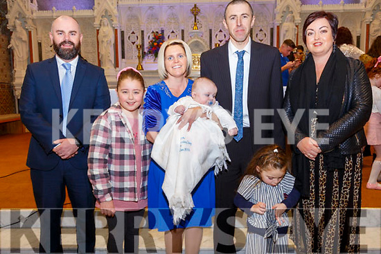 Baby Adam Carey with his parents Leisha & Aidan Carey Listowel and god parents Sheamus Murphy & Breda Murphy and sister Kacie who was christened in St. Mary's Church, Listowel by Canon Declan O'Connor on Saturday last.