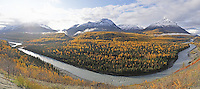 The sun rises over the Chugach Mountains, illuminating fall colors along a turn of the Matanuska River some 75 miles northeast of Anchorage. The Chickaloon River enters the Matanuska at the far right of the image.