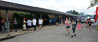 NWA Democrat-Gazette/ANDY SHUPE<br /> A long line of residents wraps around Alma Middle School Saturday, Aug. 10, 2019, before the start of the River Valley Kick Start in Alma. Inspired by her daughter, Harper, attorney Carrie Jernigan bought all 1,500 pairs of shoes from a closing Payless Shoe Source in Fort Smith. Her effort national publicity and thousands of dollars in donations, which she used to buy more shoes and school supplies for kids going back to school.