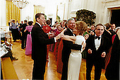 Frank Sinatra dances with First Lady Nancy Reagan in the East Room of the White House in Washington, D.C. on February 6, 1981 as United States President Ronald Reagan attempts to cut-in at the President's birthday party..Mandatory Credit: Michael Evans - White House via CNP