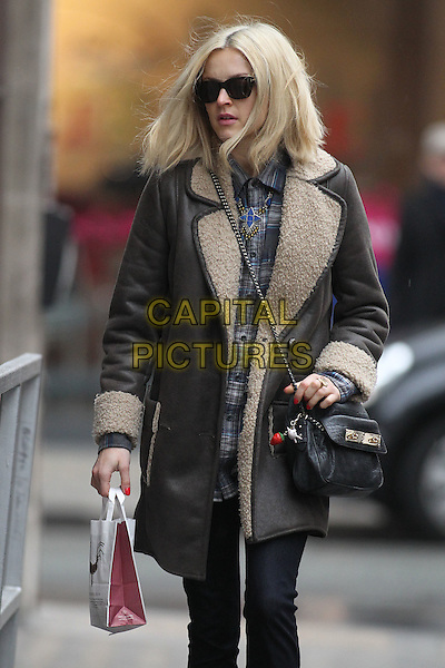 Fearne Cotton in central London, England..March 7th, 2012.half 3/4 length black brown sheepskin coat jacket bag purse jeans denim sunglasses shades check shirt leather .CAP/HIL.©John Hillcoat/Capital Pictures .