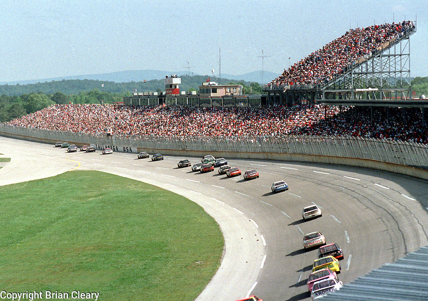 action frontstretch crowd grandstand Winston 500 at Talladega Superspeedway in Talladega , AL in May 1989.  (Photo by Brian Cleary/www.bcpix.com)
