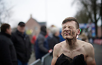 Kenneth Van Compernolle (BEL/CCN-Metalac) scrubbing off his post finish mud face<br /> <br /> Azencross Loenhout 2014
