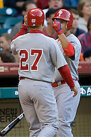 Philadelphia Phillies OF Shane Victorino greets Placido Polanco (27) against the Houston Astros on Turn Back the Clock Nite. Game played on Saturday April 10th, 2010 at Minute Maid Park in Houston, Texas.  (Photo by Andrew Woolley / Four Seam Images)