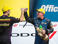 Oct 2, 2016; Mohnton, PA, USA; NHRA funny car driver Tommy Johnson Jr (right) celebrates with pro stock driver Vincent Nobile after winning the Dodge Nationals at Maple Grove Raceway. Mandatory Credit: Mark J. Rebilas-USA TODAY Sports