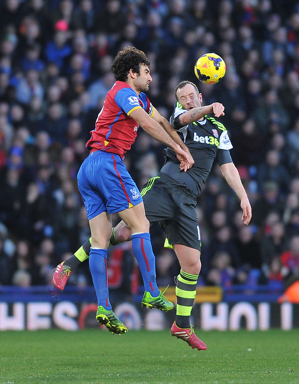 Stoke City's Charlie Adam tussles with Crystal Palace's Mile Jedinak<br /> <br /> Photo by Ashley Western/CameraSport<br /> <br /> Football - Barclays Premiership - Crystal Palace v Stoke City - Saturday 18th January 2014 - Selhurst Park - London<br /> <br /> &copy; CameraSport - 43 Linden Ave. Countesthorpe. Leicester. England. LE8 5PG - Tel: +44 (0) 116 277 4147 - admin@camerasport.com - www.camerasport.com