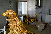 "Baghdad, Iraq, April 13, 2003.Saddam's gold plated eagle-shaped throne, inside the looted ""Triumphant Leader Museum"", entirely dedicated to the glory of Saddam Hussein, set on fire today."