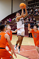 Westside Eagle Observer/RANDY MOLL<br /> Gentry's Brian Magana goes up for a shot over Gravette defenders during play in Gentry on Feb. 4, 2020.