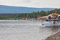 Float planes lined up along the shore of Naknek Lake in Katmai National Park, Alaska