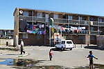 A block of flats in town of Atlantis.  Atlantis is a town in Western Cape, South Africa, roughly 40km from Cape Town. It has approximately 210,000 residents. The city suffers under high levels of poverty and unemployment. Due to Atlantis's high poverty rates, it has been acknowledged by NGO Molo Songololo as a high risk area for the trafficking of children and young persons into Cape Town, with inter boarder child trafficking cases already been reported.  Poverty has a direct link sexual exploitation and trafficking, which is happening and increasing, with young people being tricked by a false offer of work or a better life in the city.