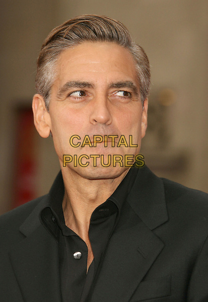 """GEORGE CLOONEY.""""Ocean's Thirteen"""" Los Angeles Premiere held at Grauman's Chinese Theatre, Hollywood, California, USA..June 5th, 2007.headshot portrait lips pursed funny face .CAP/ADM/RE.©Russ Elliot/AdMedia/Capital Pictures"""
