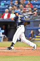 Asheville Tourists designated hitter Josh Fuentes (19) swings at a pitch during a game against the Kannapolis Intimidators at McCormick Field on May 19, 2016 in Asheville, North Carolina. The Intimidators defeated the Tourists 10-7. (Tony Farlow/Four Seam Images)