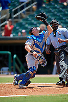 Biloxi Shuckers catcher Tyler Heineman (8) tracks a pop up behind the plate in front of home plate umpire Edwin Moscoso during a game against the Montgomery Biscuits on May 8, 2018 at Montgomery Riverwalk Stadium in Montgomery, Alabama.  Montgomery defeated Biloxi 10-5.  (Mike Janes/Four Seam Images)