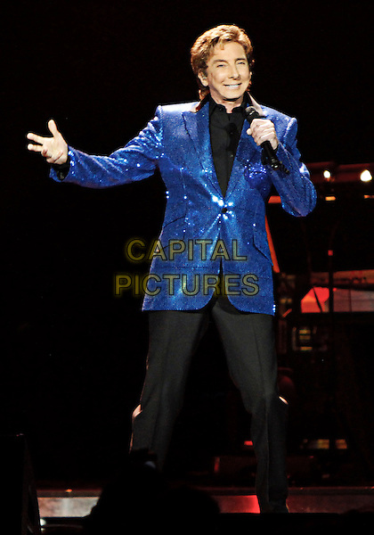 Barry Manilow .brought his Manilow on Broadway Tour to the Gwinnett Arena in Duluth, GA, where he performed his numerous hits and more for the packed venue, Duluth, GA, USA, April 27th, 2013..music concert gig live on stage show performing half length blue sequined sequin jacket black shirt singing 3/4 suit trousers hand microphone .CAP/ADM/DH.©Dan Harr/AdMedia/Capital Pictures