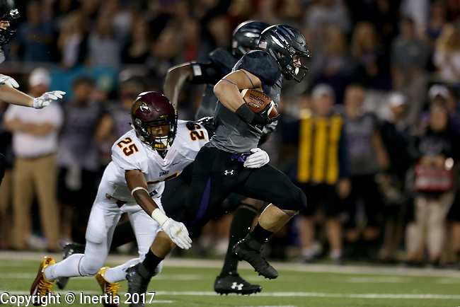 SIOUX FALLS, SD - SEPTEMBER 23: Max Mickey #22 from the University of Sioux Falls is brought down from behind by 	Will Cole #25 from Minnesota Crookston in the first half of their game Saturday night at Bob Young Field in Sioux Falls. (Photo by Dave Eggen/Inertia)