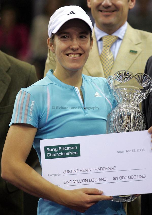 Photo: Cesar Cebolla..Sony Ericsson Championship Final. 12/11/2006.Amelie Moresmo (FRA) v  Justinne Henin-Hardene (BEL)..Justinne Henin-Hardene celebrates with the trophy.