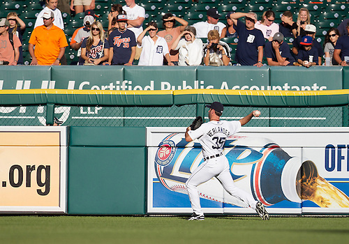 August 06, 2012:  Detroit Tigers pitcher Justin Verlander (35) warms up in the outfield as fans watch on during MLB game action between the New York Yankees and the Detroit Tigers at Comerica Park in Detroit, Michigan.  The Tigers defeated the Yankees 7-2.