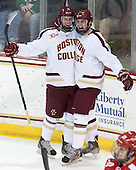 Adam Gilmour (BC - 14), Chris Calnan (BC - 11) - The Boston College Eagles defeated the visiting Boston University Terriers 6-4 (EN) on Friday, January 17, 2014, at Kelley Rink in Conte Forum in Chestnut Hill, Massachusetts.