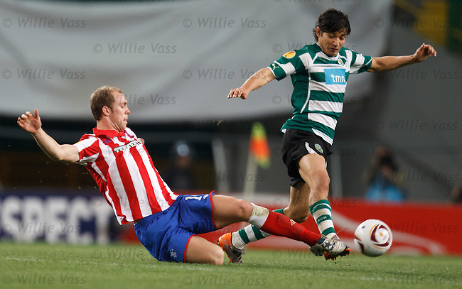 Steven Whittaker makes a tackle on Sporting's Matias Fernandez