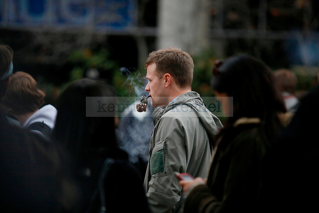 Seth Thomas, a UK law student, along with many others, gather to smoke  during the protest at the free speech area of the Student Center on Thursday..Photo by Zach Brake | Staff