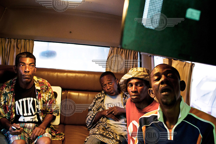 Injecting drug users watch a video about safe injection in the MDM (Medecins du Monde) bus in Dar Es Salaam.