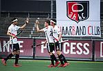 AMSTELVEEN -  Tijn Lissone (A'dam) heeft gescoord    tijdens  de  eerste finalewedstrijd van de play-offs om de landtitel in het Wagener Stadion, tussen Amsterdam en Kampong (1-1). Kampong wint de shoot outs.   rechts Johannes Mooij (A'dam) . links Roderic Schwirtz (A'dam), rechts Niek Merkus (A'dam)   COPYRIGHT KOEN SUYK