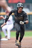 Vanderbilt Commodores third baseman Austin Martin (16) runs to third base during Game 8 of the NCAA College World Series against the Mississippi State Bulldogs on June 19, 2019 at TD Ameritrade Park in Omaha, Nebraska. Vanderbilt defeated Mississippi State 6-3. (Andrew Woolley/Four Seam Images)