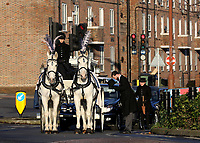 The horse and carriage funeral procession carrying the coffin of Mishi Morath approaches the Dulwich Hamlet FC Stadium during the funeral of Dulwich Hamlet FC supporter Mishi Morath at Champion Hill Stadium on 15th January 2020