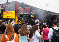 Apr 13, 2019; Baytown, TX, USA; Fans surround the pit area of NHRA top fuel driver Richie Crampton as he warms up his car during qualifying for the Springnationals at Houston Raceway Park. Mandatory Credit: Mark J. Rebilas-USA TODAY Sports