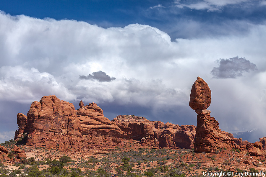 Arches National Park, UT<br /> Balanced Rock with Garden of Eden and LaSal mountains with clouds from a clearing storm
