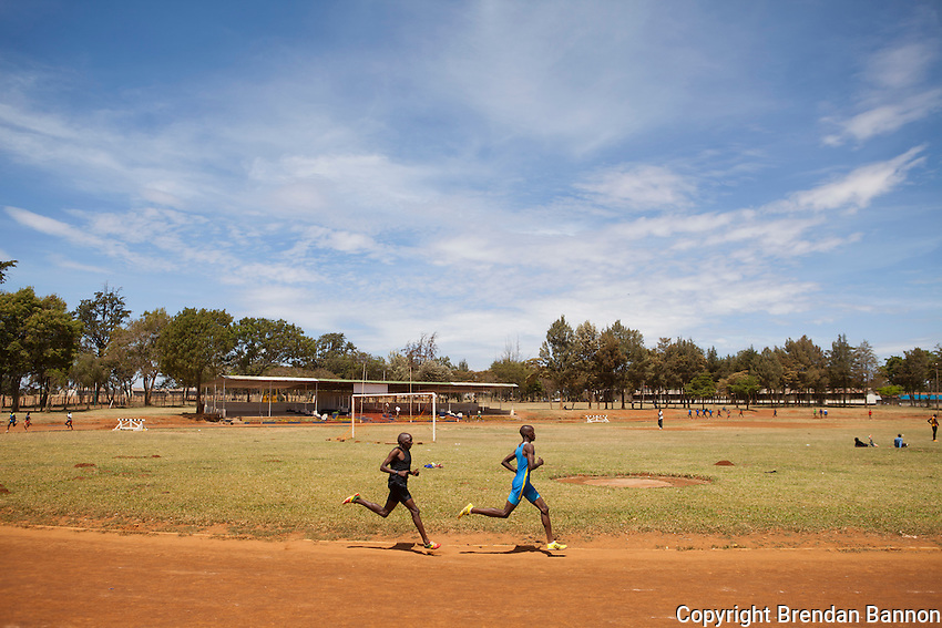 Athletes at Moi University track in Eldoret, Kenya where  amatuer and elite professional athletes train together on a  dirt track.