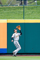 Mikel Mucha #8 of the Wichita State Shockers attempts to catch a ball in left field during a game against the Missouri State Bears at Hammons Field on May 5, 2013 in Springfield, Missouri. (David Welker/Four Seam Images)