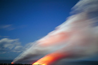 Waha'ula Lava Tube spews lava; steam plume rises as molten lava enters Pacific ocean;  Kilauea Volcano; Volcanoes National Park, Hawaii. Hawaii USA Big Island.