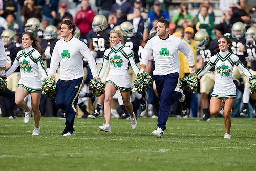 Notre Dame cheerleaders lead the team onto the field during NCAA football game between Tulsa and Notre Dame.  The Tulsa Golden Hurricane defeated the Notre Dame Fighting Irish 28-27 in game at Notre Dame Stadium in South Bend, Indiana.