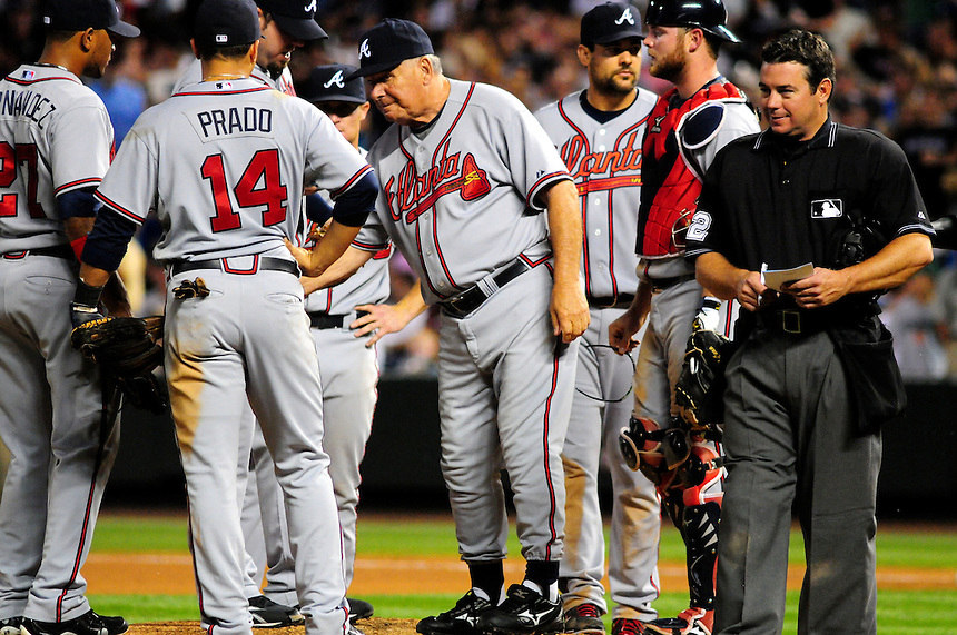 July 9, 2009: Braves manager and 2009 National League Manager of the Year candidate Bobby Cox makes a visit to the mount during a regular season game between the Atlanta Braves and the Colorado Rockies at Coors Field in Denver, Colorado. Also pictured are Braves Diory Hernandez, Martin Prado, Casey Kotchman, Brian McCann, and HP umpire Rob Drake.