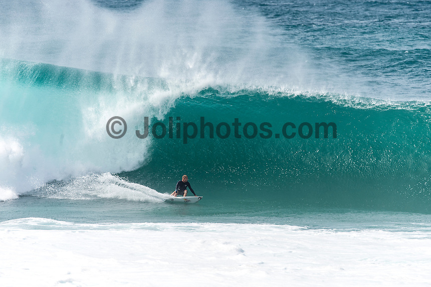 BANZAI PIPELINE, Oahu/Hawaii (Saturday, December 13, 2014)  Mick Fanning (AUS) surfing Pipeline after the contest was called off for the day. - The final stop of the 2014  World Championship Tour, the Billabong Pipe Masters in Memory of Andy Irons, was  called ON today in NW double overhead surf. <br /> Round 1 was completed as the swell continued to rise and the Easterly Trade winds increased in strength. Kelly Slater (USA) kept his World Title hopes alive after winning his heat against Reef MacIntosh (HAW). Jordy Smith(ZAF) was injured when he hit the reef at Backdoor.<br /> Conditions worsen around the end of the Round and the event was first put on hold then postponed for the day.  <br /> <br /> The Billabong Pipe Masters in Memory of Andy Irons will determine this year&rsquo;s world surfing champion as well as those who qualify for the elite tour in 2015. As the third and final stop on the Vans Triple Crown of Surfing Series  the event will also determine the winner of the revered three-event leg.<br /> <br />  Photo: joliphotos.com
