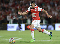 BOGOTÁ -COLOMBIA, 16-11-2014. Luis Carlos Arias jugador de Santafe en acción durante el encuentro entre Independiente Santa Fe y Atlético Nacional por la fecha 1 de los cuadrangulares finales de la Liga Postobón II 2014 jugado en el estadio Nemesio Camacho El Campín de la ciudad de Bogotá./ Luis Carlos Arias player of Santa Fe in action during the match between Independiente Santa Fe and Atletico Nacional for the first date of the final quadrangular of the Postobon League II 2014 played at Nemesio Camacho El Campin stadium in Bogotá city. Photo: VizzorImage/ Gabriel Aponte / Staff