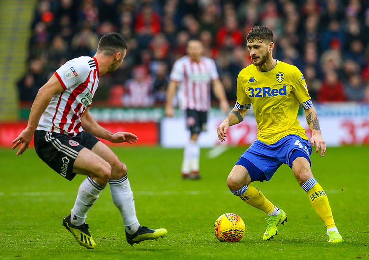 Leeds United's Mateusz Klich takes on Sheffield United's Enda Stevens<br /> <br /> Photographer Alex Dodd/CameraSport<br /> <br /> The EFL Sky Bet Championship - Sheffield United v Leeds United - Saturday 1st December 2018 - Bramall Lane - Sheffield<br /> <br /> World Copyright © 2018 CameraSport. All rights reserved. 43 Linden Ave. Countesthorpe. Leicester. England. LE8 5PG - Tel: +44 (0) 116 277 4147 - admin@camerasport.com - www.camerasport.com