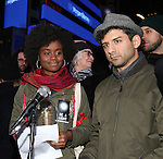 Denee Benton and Tony Yazbeck attend The Ghostlight Project to light a light and make a pledge to stand for and protect the values of inclusion, participation, and compassion for everyone - regardless of race, class, religion, country of origin, immigration status, (dis)ability, gender identity, or sexual orientation at The TKTS Stairs on January 19, 2017 in New York City.
